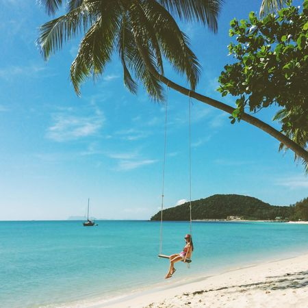 Lost In The Landscape Bestsellers Idyllic Scenery Leisure Activity Swinging Palm Tree Young Women One Woman Only Vacations Outdoors Tranquil Scene Travel Destinations Sand Full Length Water Tropical Paradise Paradise Beach Sea Palm Trees Traveling Travel Travel Photography Relaxing Soaking Up The Sun