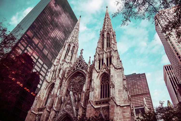 St. Patrick's Cathedral Architecture Built Structure Building Exterior Place Of Worship Belief Building Religion Sky Spirituality Low Angle View Travel Destinations History The Past Cloud - Sky Day Tower No People Outdoors Spire  Gothic Style Ornate Office Building Exterior Skyscraper