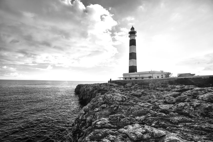 Lighthouse Building Exterior Sky Cloud - Sky Outdoors Bnw Bnw_society Bnw_life Monochrome Bnw_captures Blackandwhite Scenics Faded Faro Balearics Minorca Architecture Rock - Object Travel Destinations Artrutx Landscape Landscape_photography Sea Sea And Sky The Great Outdoors - 2017 EyeEm Awards