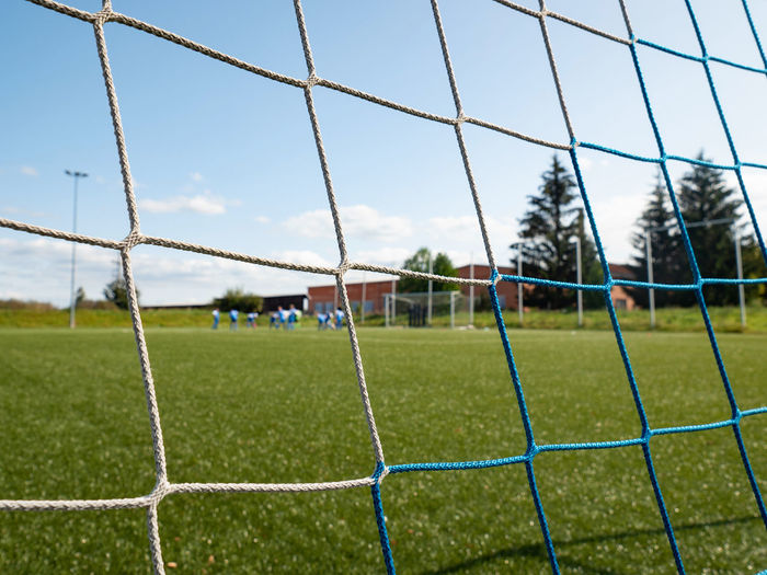 Scenic view of soccer field against sky