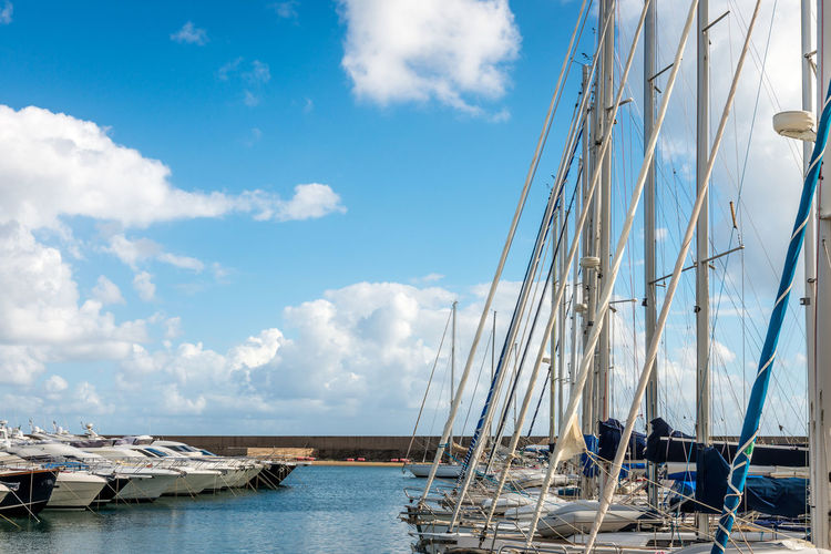 Abundance Blue Boat Calm Cloud Cloud - Sky Day Harbor Large Group Of Objects Mast Mode Of Transport Moored Nautical Vessel No People Ocean Outdoors Sailboat Sailing Ship Sea Sky Tranquil Scene Tranquility Transportation Water Waterfront