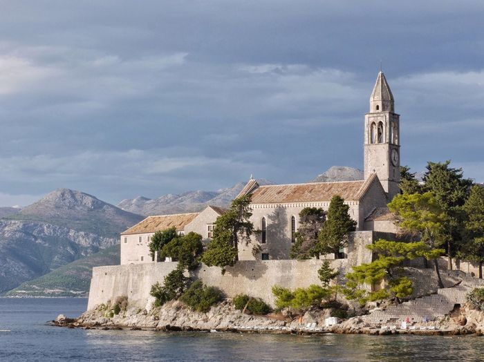 Franciscan Monastery on Lopud island, Croatia Architecture Religion Built Structure Spirituality Place Of Worship Building Exterior Sky No People Day Mountain History Water Outdoors Nature Travel Destinations Cloud - Sky Tree Croatia The Week On EyeEm Dubrovnik Lopud Travel Travel Photography