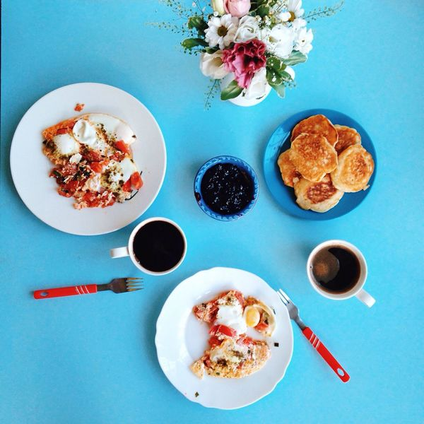 Freshness Food Plate Of Food Plate Ready-to-eat Still Life Spoon Directly Above Breakfast Meal Serving Size Served Cup Of Coffee Overhead View Close-up Blue Background Flowers On Table Pancakes Fried Egg Food On The Table Mealtime Multi Colored White Plate Visual Feast Food Stories Summer Exploratorium