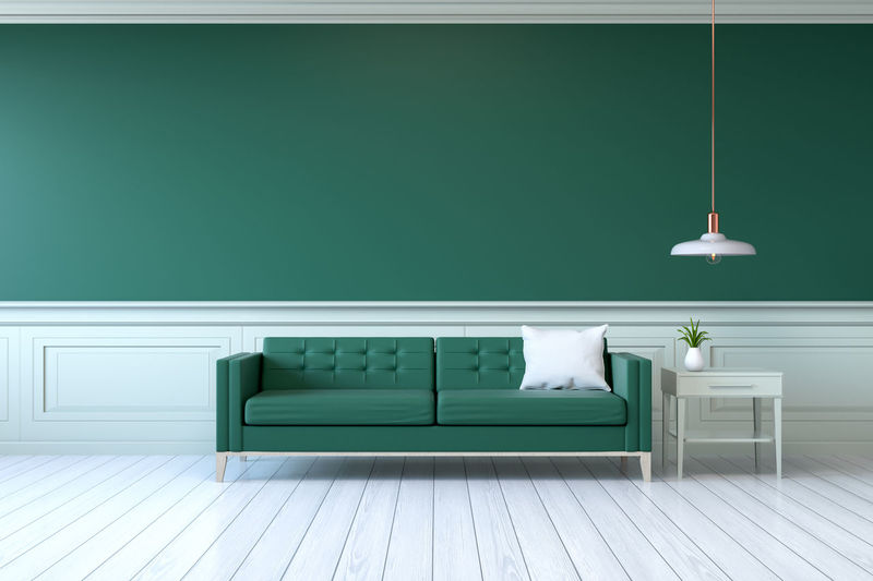 Green Sofa With Table By Wall At Home