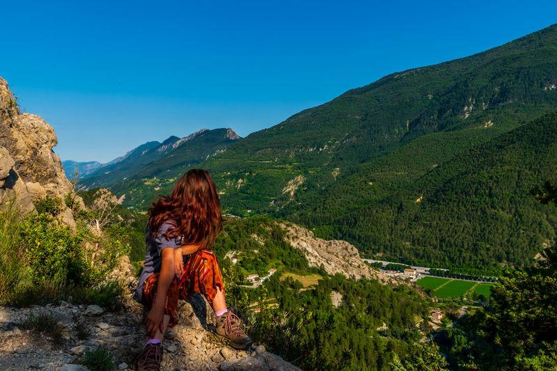 Full length of senior woman against mountains