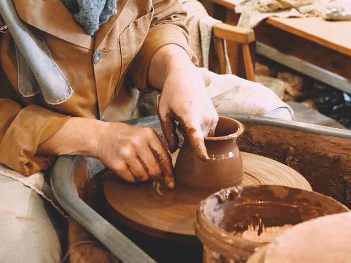 Craftsperson Making Pottery