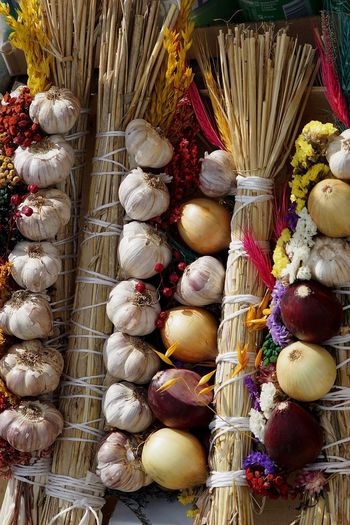 Close-up of onions and garlic at market