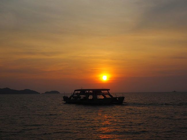 Ferry on the quiet sea. Thailand Mountain HelloEyeEm Evening TRVEL Lovely Outside Sea Sunset Water Sky Sun Nautical Vessel Cloud - Sky Transportation Nature Orange Color Seascape No People Ship Mode Of Transportation Travel Outdoors Scenics - Nature Beauty In Nature Sunlight Passenger Craft