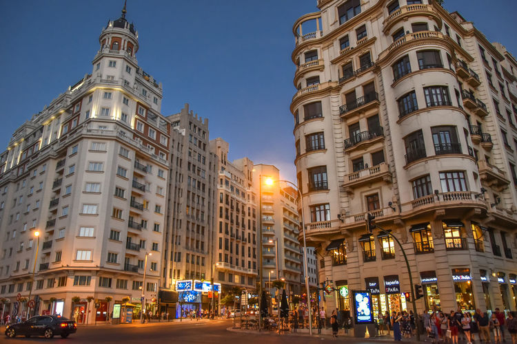 Madrid Summer Travel Madrid Evening City Illuminated Clear Sky Cityscape Sky Architecture Building Exterior Art Deco Tower Street Light Tall - High Urban Skyline Building Office Building High Street City Street