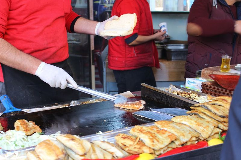 Street Food Fried Food Serving Size Eat Eating Food Sandwich Hamburger Bread Bread Hands Hygiene Gloves Cooked