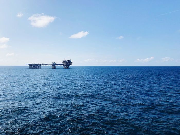 Wellhead unman platform in the middle of the sea Sea And Sky Offshore Work Offshore Life Offshore Platform Oil And Gas Industry Water Sky Sea Horizon Over Water Scenics - Nature Horizon Day Beauty In Nature Blue Nature No People Cloud - Sky Mode Of Transportation Outdoors