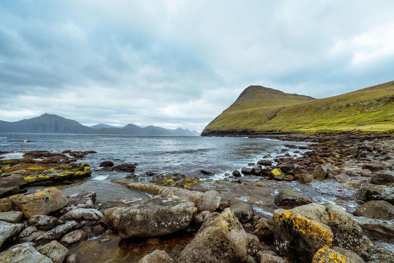 Faroe islands Beauty In Nature Cloud - Sky Day Faroe Islands Grass Landscape Mountain Nature No People Outdoors Rock - Object Scenics Sea Sky Tranquil Scene Tranquility Water