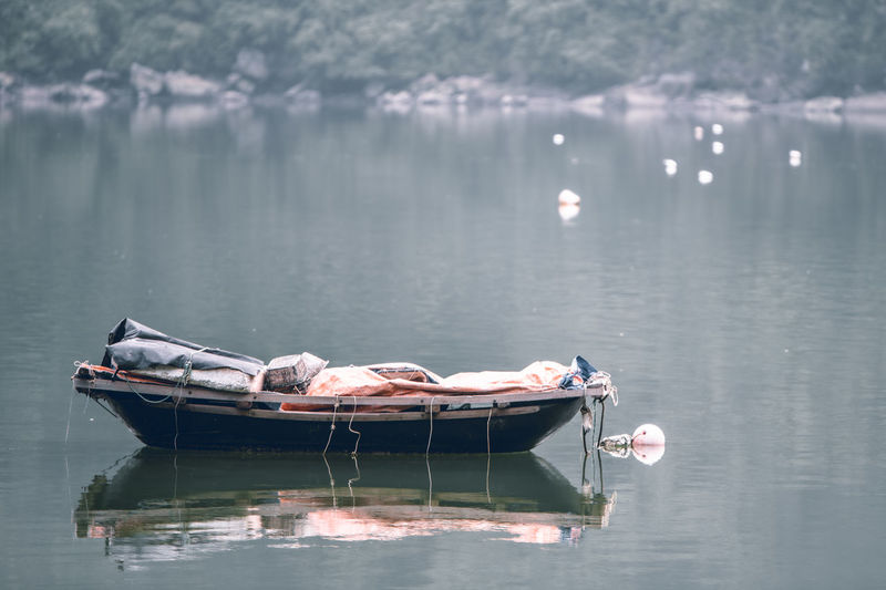 Man lying on boat in lake