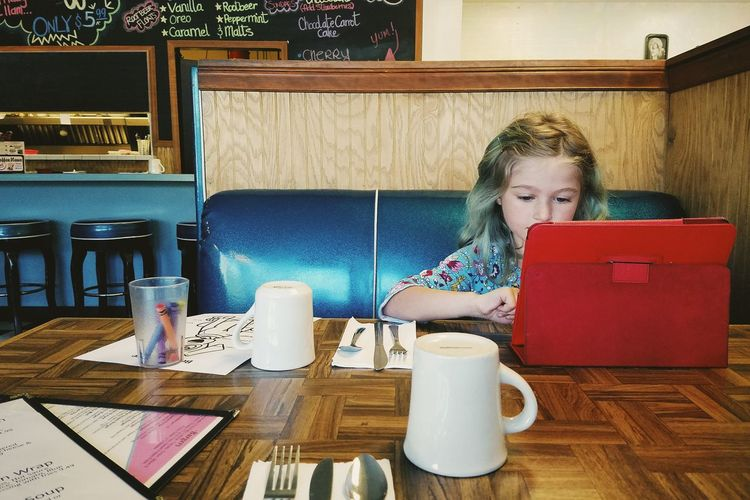 Business Lunch Mobile Conversations One Person People Food And Drink FaceTime Young Adult Ipad Table Restaurant