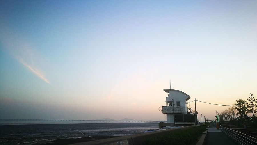 Youngjong Island City Water Cityscape Sunset Statue Sea History Sky Architecture Building Exterior Horizon Over Water Ocean Seascape Coast