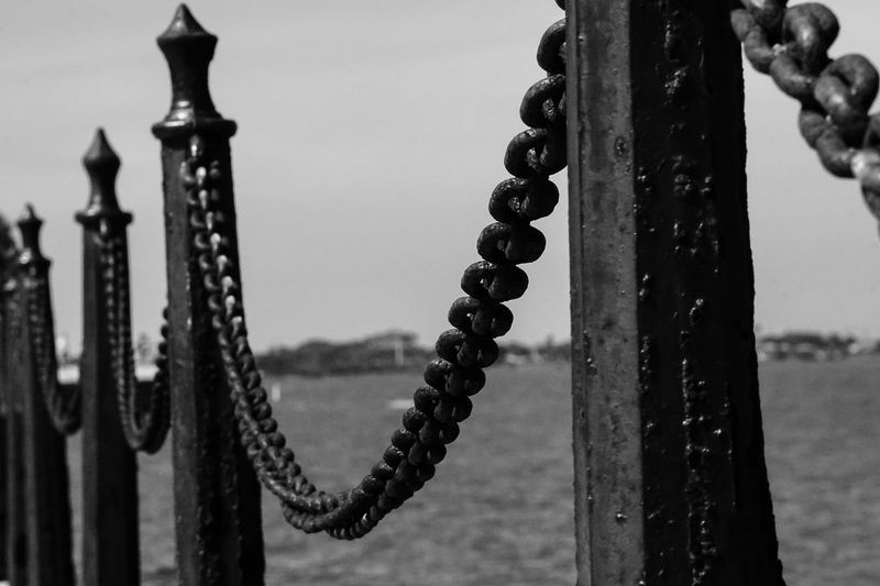 Chain Close-up Day Detail Focus On Foreground Metal Metallic Nature No People Outdoors Part Of Pole Protection Rusty Safety Security Selective Focus Sky St Augustine, FL Strength Wooden Post