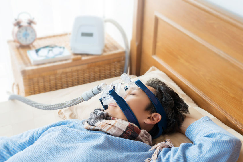 Man and cpap mask.Middle aged man with obstructive sleep apnea symptoms sleeping well on his back by wearing cpap mask,healthcare concept. Back Choking Continuous Positive Airway Pressure Home Snoring Tube Bedroom Concept Cpap Happiness Healthcare And Medicine Healthy Lifestyle High Angle View Lying Down Lying On Back Mask Obstructive Sleep Apnea Senior Men Sleep Apnea Sleeping Symptoms