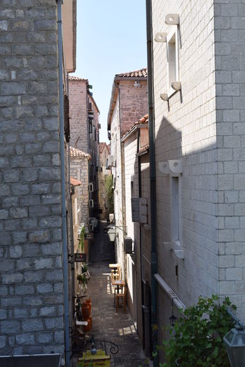 Budva Budva,Montenegro Alley Architecture Brick Budva Old Town Building Building Exterior Built Structure City Day Direction Footpath House Montenegro Narrow Nature No People Outdoors Plant Potted Plant Residential District Street The Way Forward Town