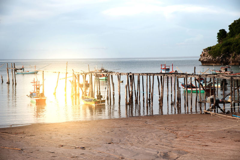 Sunset on the beach in Southern of Thailand. Light Pile Of Wood Sunlight Beach Beauty In Nature Bridge - Man Made Structure Day Horizon Over Water Nature Nautical Vessel No People Outdoors Pillars Sand Scenics Sea Sky Sunset Traditional Tranquil Scene Tranquility Tree Water Wood - Material