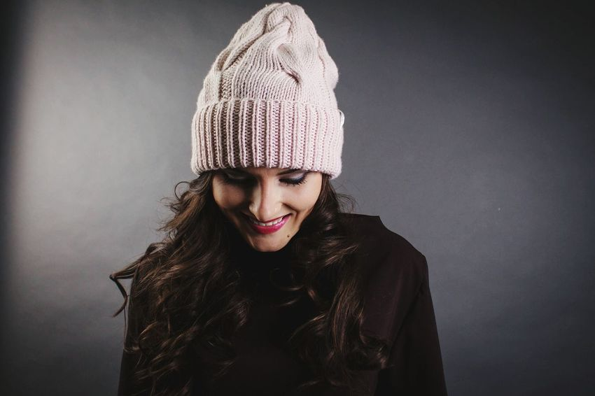 Designer Irina Yuzhakova. Knit Hat Warm Clothing One Person One Woman Only Winter Adults Only Only Women Headshot People Knitted  Happiness Scarf Young Adult Adult One Young Woman Only Smiling Headwear Day Casual Clothing Winter Mywork Beautiful Woman Studio Shot Beautiful People