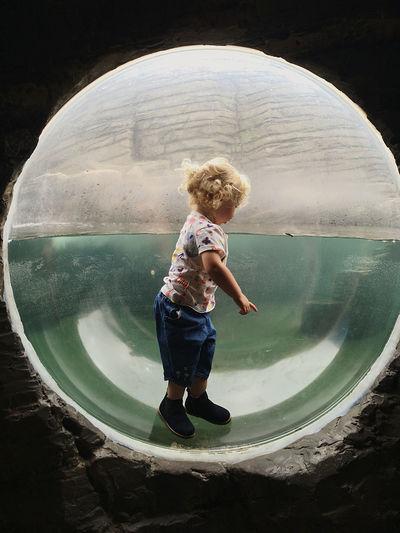 Full length of boy standing in water