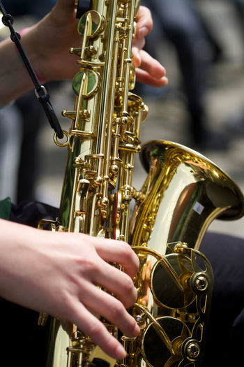 Cropped Image Of Street Performer Playing Saxophone