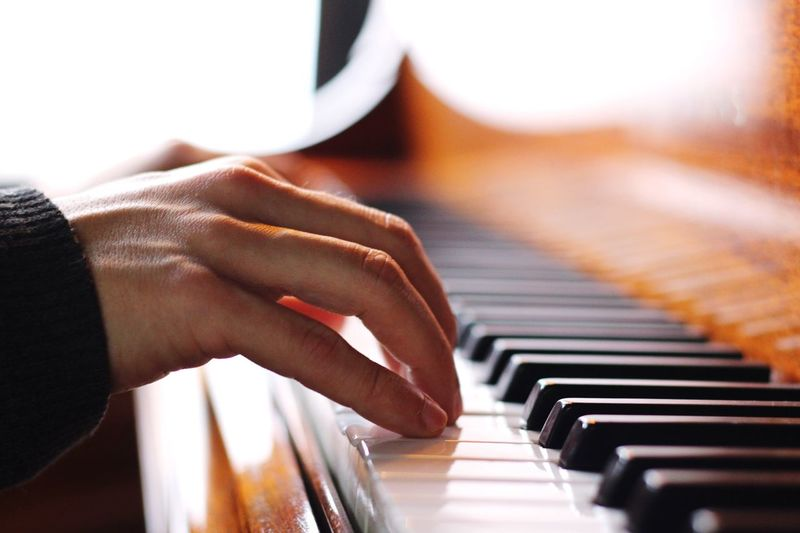 Close-Up Of Hand Playing Piano
