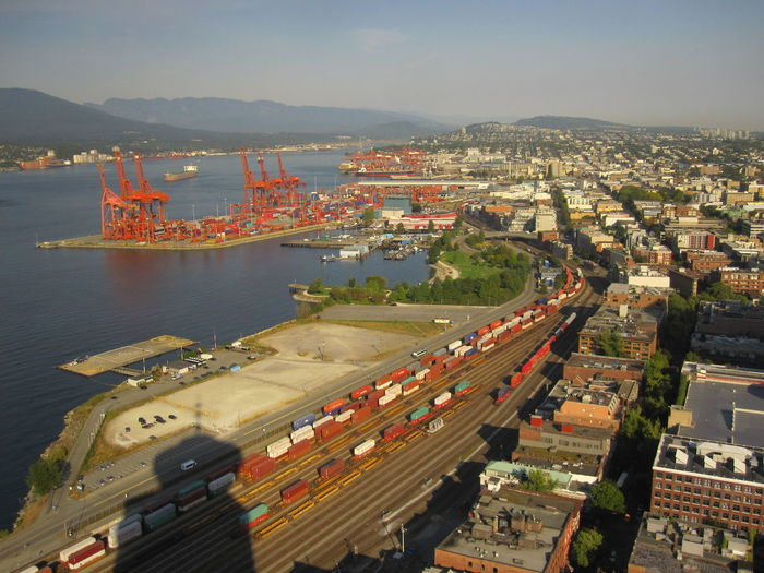 Aerial view of commercial dock at harbor in city
