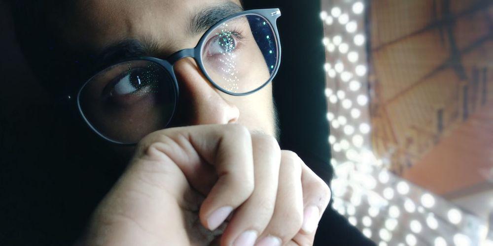 Close-Up Of Thoughtful Man Wearing Eyeglasses