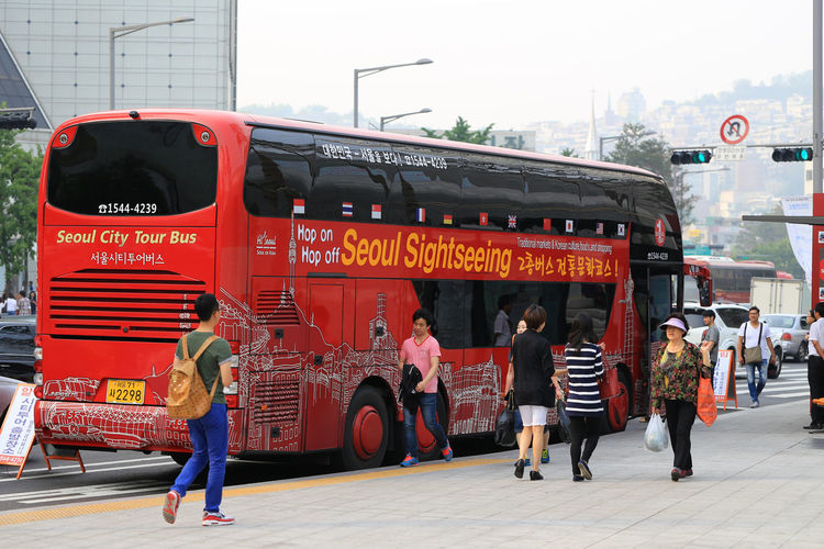 Seoul Sightseeing bus, a touristic bus service that shows the city with an audio guide Audio Guide Bus Service Footpath Service Sightseeing Sightseeing Bus Travel City City Life Destination Hop On Hop Off Outdoors Street Transportation