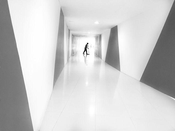 Rear view of woman in corridor