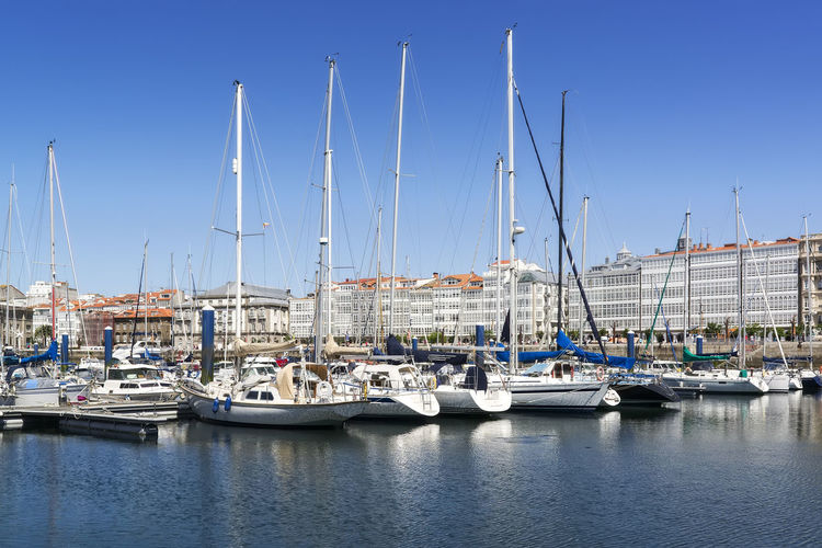 Coruna marina por with sailboats and typical glass buildings , Spain A Coruña A Coruña City Coruña Galicia Spain Galicia Galicia Calidade Galicia, Spain SPAIN Architecture Coruña Harbor Marina Mast Mode Of Transportation Moored Nautical Vessel Pole Port Sailboat Spaın Transportation Waterfront Yacht