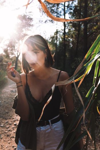Sunset Folk One Person Leisure Activity Lifestyles Real People Tree Plant Sunlight Front View Nature Land Day Young Adult Women Adult Forest Young Women Standing Outdoors