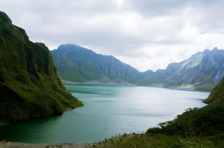 Mt. Pinatubo crater lake Crater Lake Volcano Crater Beauty In Nature Day Grass Landscape Mountain Nature No People Outdoors Scenery Scenics Sky Tranquil Scene Tranquility Water EyeEmNewHere The Great Outdoors - 2018 EyeEm Awards