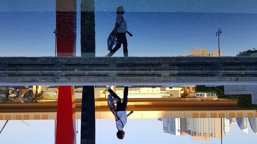 Underworld Reflection Outdoors Day Photography Dubai DubaiMall United Arab Emirates EyeEm Gallery EyeEm Best Shots EyeEm Lights And Shadows People Travel Water Pebbles Stones Mirror Lady Perspective