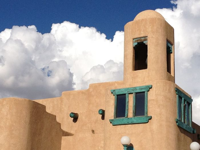 Southwestern New Mexico's beautiful Spanish architecture Architecture Beauty In Nature Blue Built Structure Cloud Cloud - Sky Cloudy Day Low Angle View Mountain Nature No People Outdoors Scenics Sky Tranquil Scene Tranquility Weather