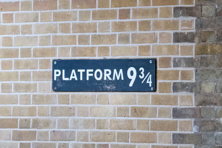 Platform 9 3/4 in King's Cross Station Harry Potter King's Cross, St Pancras International Architecture Brick Wall Building Exterior Close-up Communication Day Nameplate No People Platform 9 3/4  Text Wall - Building Feature