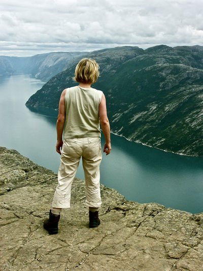 Lysefjord Norway🇳🇴 Beauty In Nature Cloud - Sky Day Mountain Mountain Range Nature Non-urban Scene One Person Outdoors Real People Rear View Scenics - Nature Trip Water