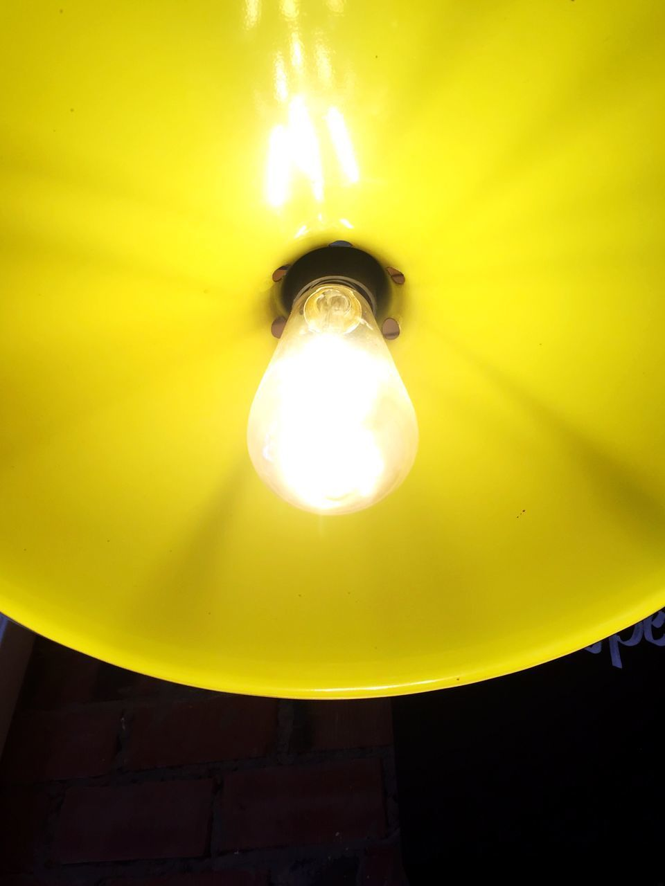 LOW ANGLE VIEW OF ILLUMINATED ELECTRIC LIGHT BULB