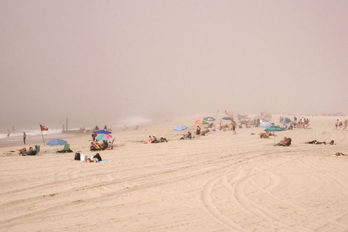 Capemay Beachphotography Foggy Weather Hanging Out Relaxing Beach Sand People Beachumbrellas Beach Time