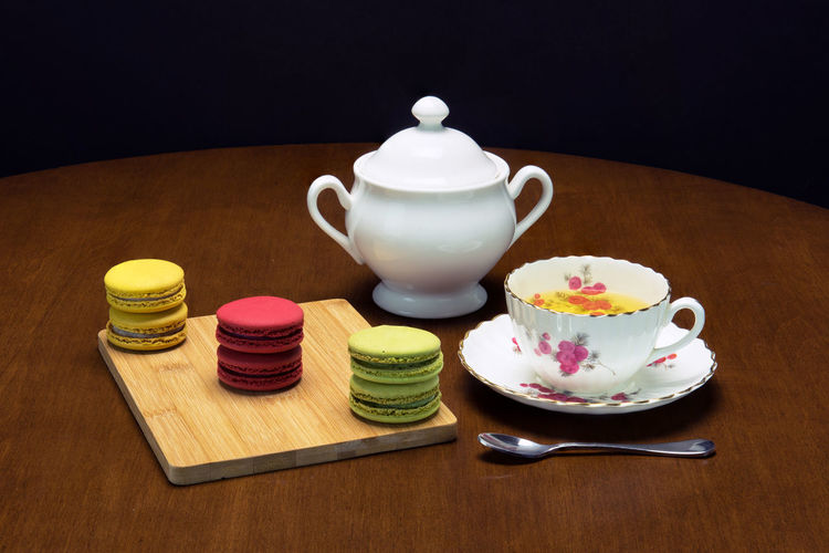 Close-up of macaroon and tea on table