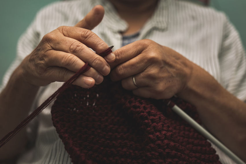 close up of old woman's hands knitting Human Hand One Person Midsection Hand Holding Knitting Knitting Needle Art And Craft Wool Craft Human Body Part Indoors  Close-up Textile Skill  Senior Adult Adult Focus On Foreground Front View Real People Obscured Face Old Woman Cosy