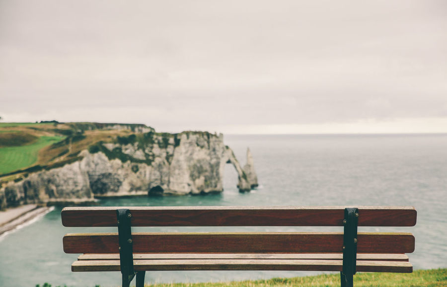 Absence Beach Beauty In Nature Bench Bench Cloudy Coastline Escapism Getting Away From It All Idyllic Landscape The Great Outdoors - 2016 EyeEm Awards The Great Outdoors With Adobe Outdoors Remote Resting Place Rock Formation Scenics Sea Solitude Tranquil Scene Tranquility Vacations Viewpoint étretat