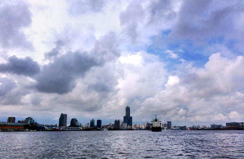 Dramatic sky and the silhouette of Kaohsiung City and port Dramatic Sky Harbor Kaohsiung Silhouette Taiwan City Cityscape Cloud - Sky Landmark Ocean Port Urban Skyline Water Waterfront