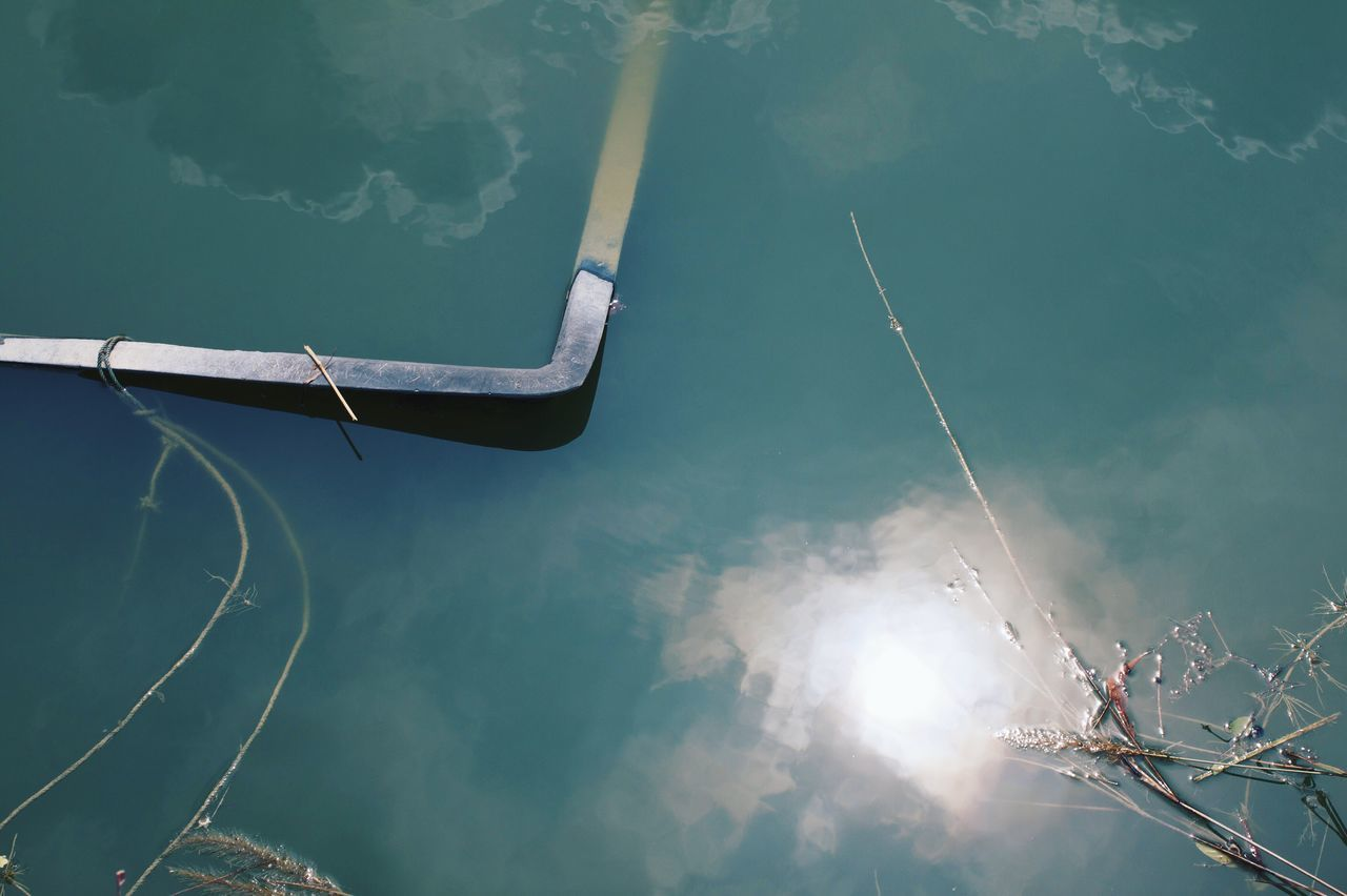 High angle view of metallic structure in lake