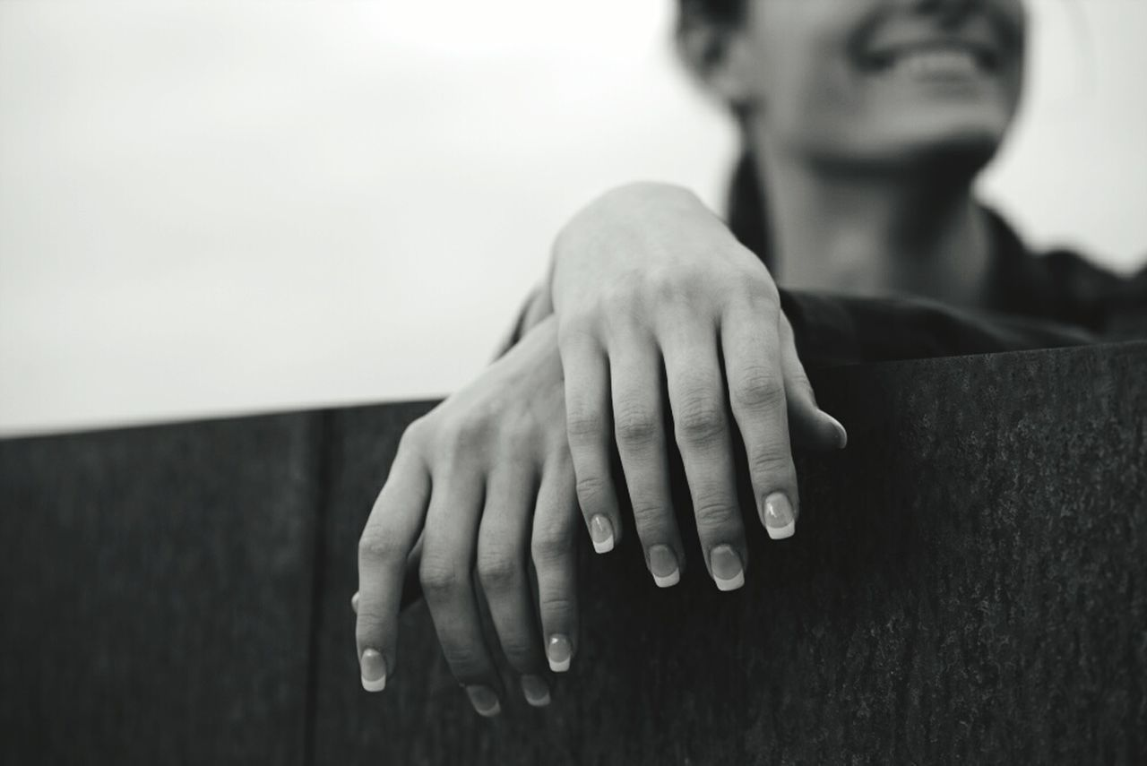 CLOSE-UP OF HAND TOUCHING HANDS
