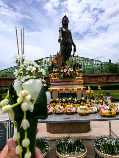 Queen Chammadevi in Hariphunchai era Statue Flower Human Representation Sculpture Religion Cloud - Sky Sky Spirituality Plant No People Outdoors Day Cultures Lamphun ,Thailand Travel Destinations Spirituality Spiritual Ancient Civilization Thailand🇹🇭 Statue History Ancient Ancient History Lamphun Province Thailand Archaeology