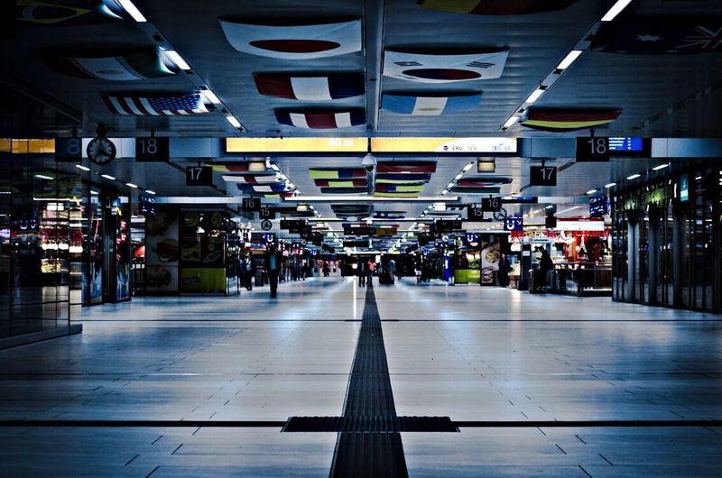 Spacious corridor in shopping mall