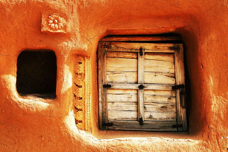 Closed Wooden Window Of Old Mud Hut