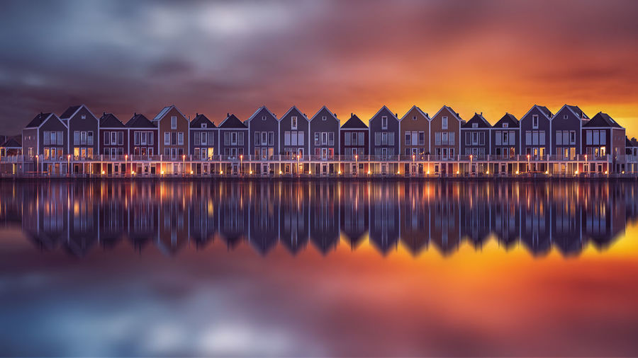 Amsterdam EyeEm Best Shots EyeEm Gallery EyeEmNewHere Architecture Beach Building Building Exterior Built Structure Cloud - Sky Dusk Dutch House In A Row Nature No People Orange Color Outdoors Reflection Remo SCarfo Scenics - Nature Sea Sky Sunset Water